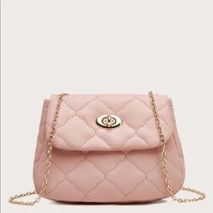Handbags - Pink Quilted Twist Lock Saddle Bag